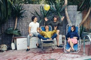 John, Paul, George and Ringo play with a balloon. (Courtesy the Bob Bonis Archive)