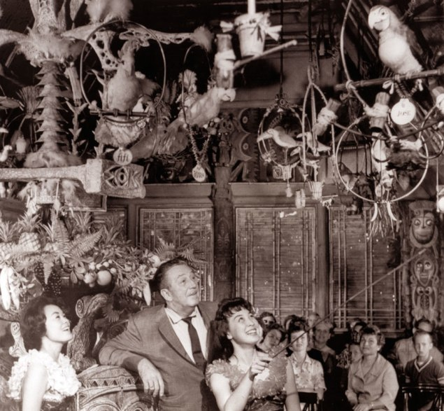 A photo of Walt Disney looking at an original Disneyland Tiki Bird from the enchanted Tiki Room, which is also offered in the sale and estimated $20,000-$25,000. (Courtesy Van Eaton Galleries)