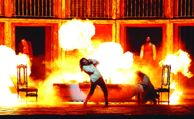 Hell arrives to claim Peter Mattei's Don. (Photo by Marty Sohl/Metropolitan Opera)