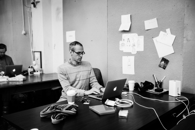 Alex Blumberg at work in the Gimlet office. (Photo by Emily Assiran/New York Observer)