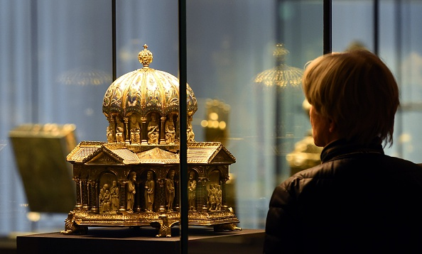 A visitor looks at the the cupola reliquary (Kuppelreliquar) of the so-called 'Welfenschatz' (Guelph Treasure) displayed at the Kunstgewerbemuseum (Museum of Decorative Arts) in Berlin. (Photo credit should read TOBIAS SCHWARZ/AFP/Getty Images)