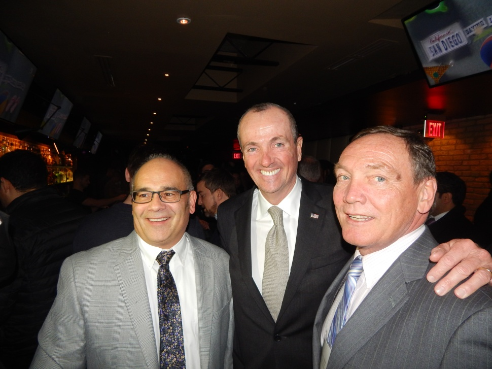 Gusciora, left, and Eustace, right, with former U.S. Ambassador to Germany Phil Murphy.