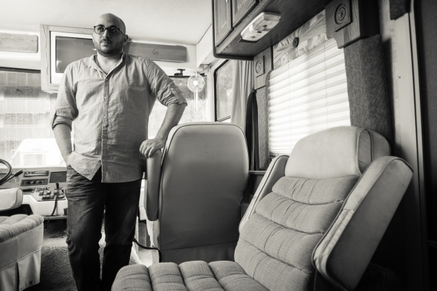 Husam Al-Sayed inside the CULTURERUNNERS RV, at MIT. (Courtesy of Edge of Arabia. Photo by John Mireles)