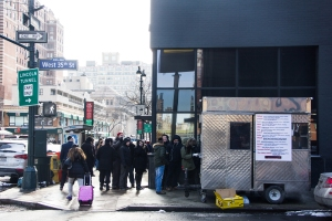 People lining up on the corner of West 35th Street and 9th Avenue for their kosher lunch