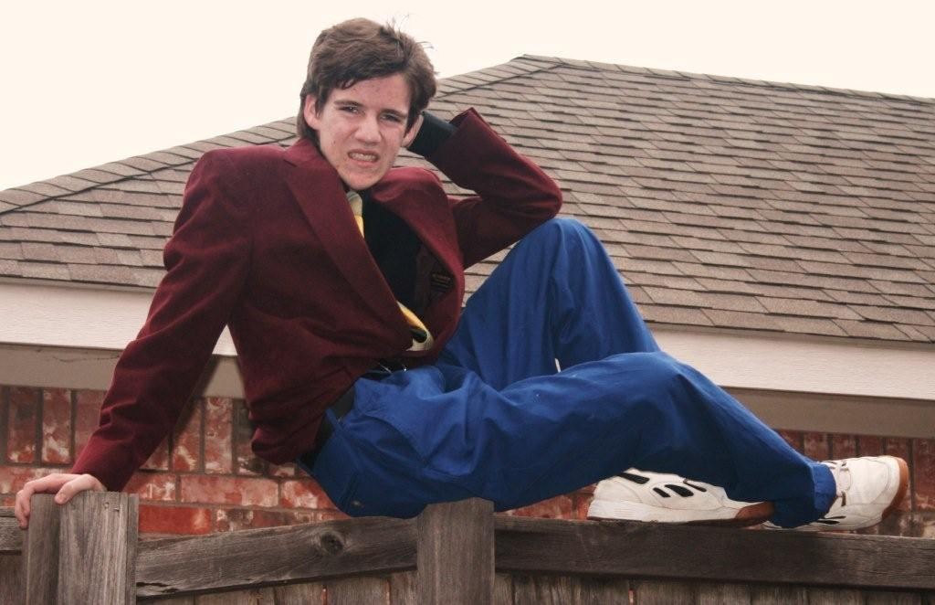 """The cover image for """"I'm Just Sitting on a Fence,"""" Dax Flame's self-help book. (Photo: Dax Flame)"""