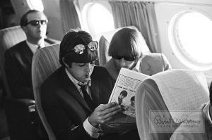 Paul McCartney and Ringo Starr on an Airplane, California, August 1965. (Courtesy the Bob Bonis Archive)