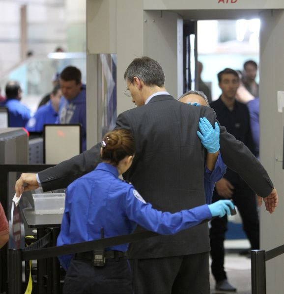 An air traveler is patted down after passing through a full-body scanner at Los Angeles International Airport (LAX) on February 20, 2014 in Los Angeles, California. (Photo: David McNew/Getty Images)