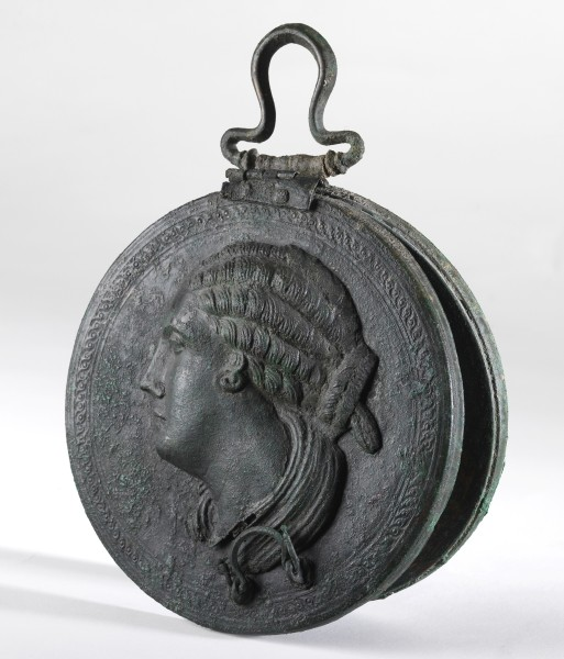 Belfer Collection, Bronze mirror with a woman head in relief, Hellenistic period, late 4th-3rd century BCE. (Photo © The Israel Museum, Jerusalem, by Elie Posner)