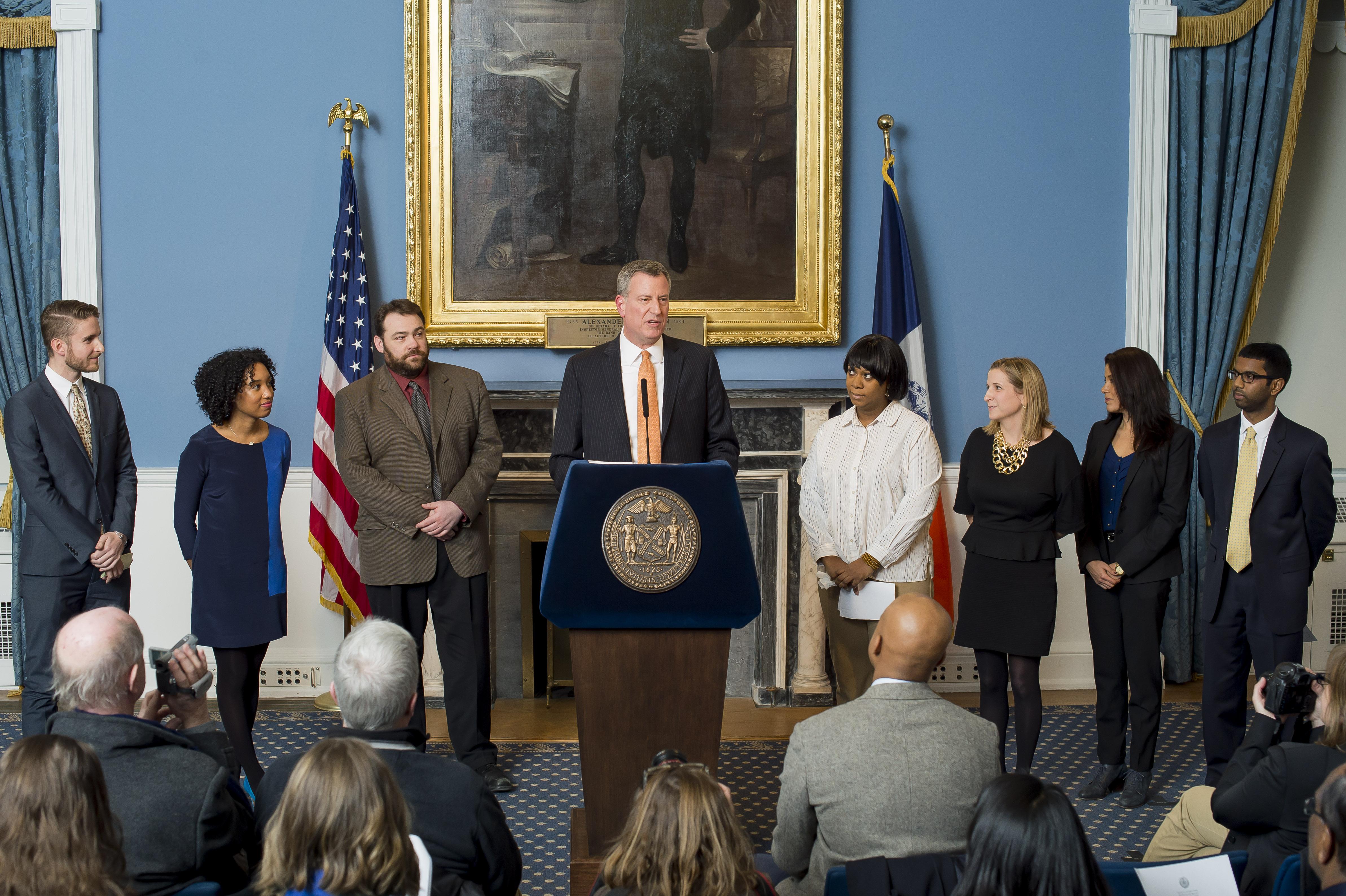 Mayor Bill de Blasio with members of his press team in January 2014.