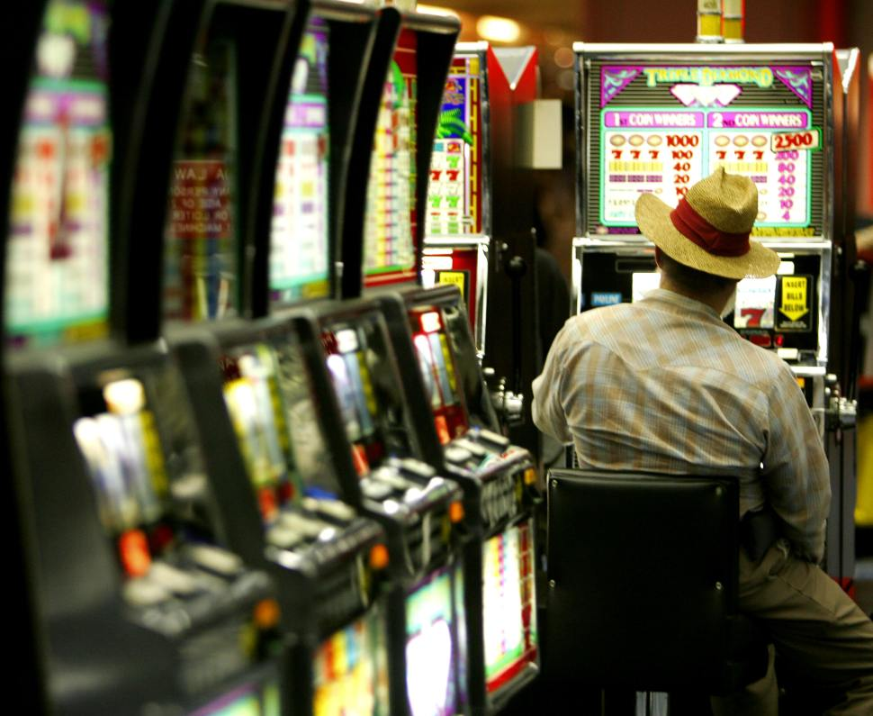 A late night gambler plays the slot machines 03 May 2005 in Las Vegas,Nevada. AFP Photo/Paul J. RICHARDS (Photo credit should read PAUL J.RICHARDS/AFP/Getty Images)