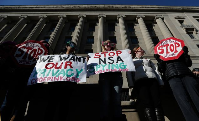 Protesters outside the Justice Department. NSA whistleblower Bill Binney agrees with many of their complaints. (Photo: Win McNamee/Getty Images)