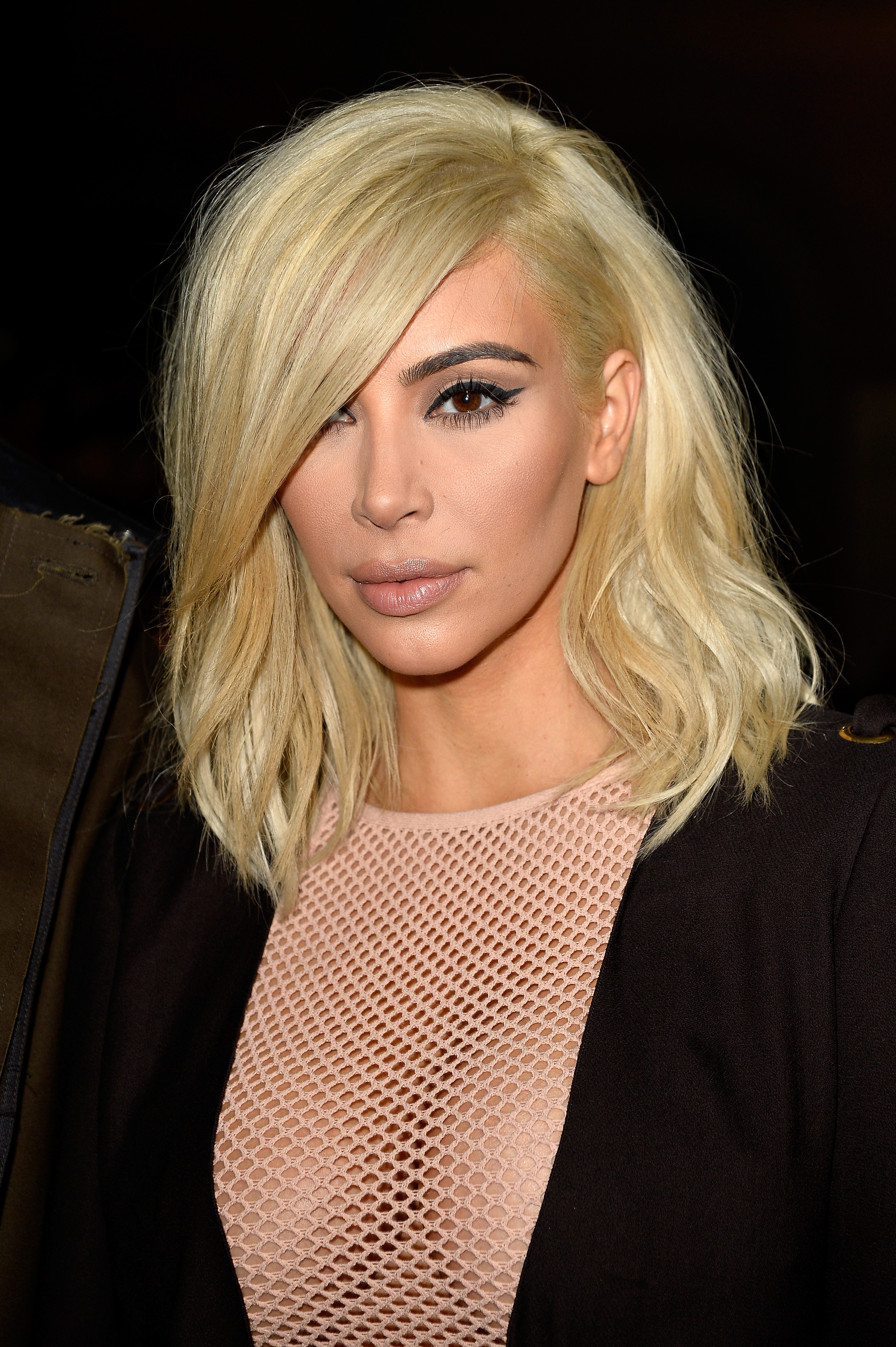 Ms. Kardashian fluffed up her hair sometime between the Balmain and Lanvin shows yesterday (Photo: Getty).
