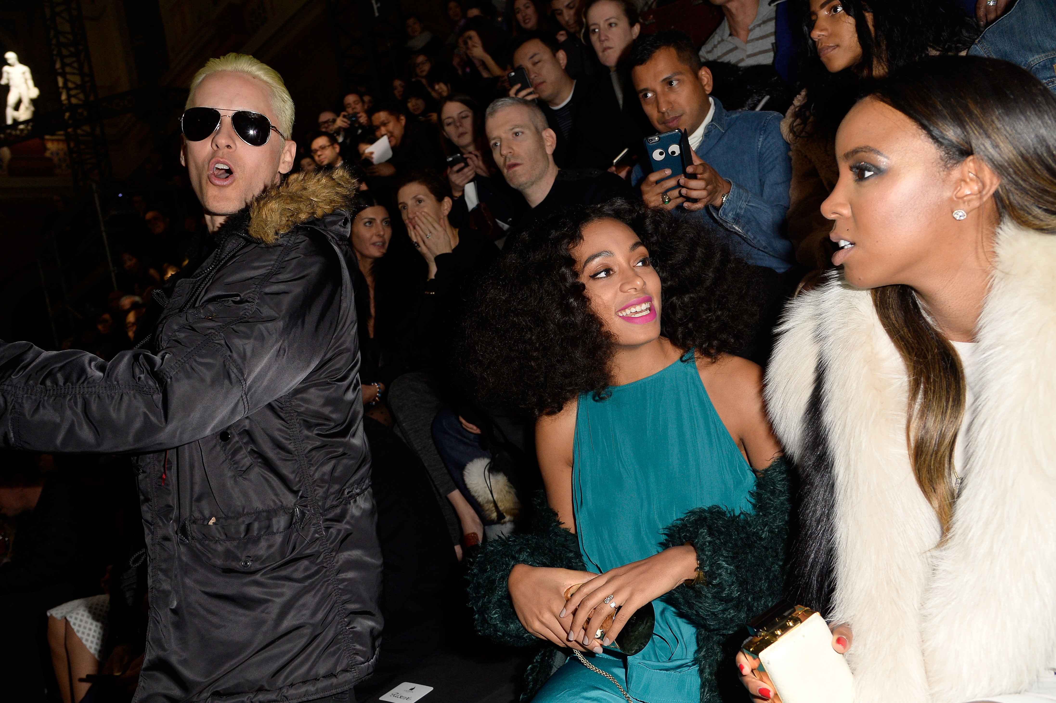 Jared Leto yells (maybe in French?) while passing Solange Knowles and Kelly Rowland at the Lanvin show (Photo: Getty).