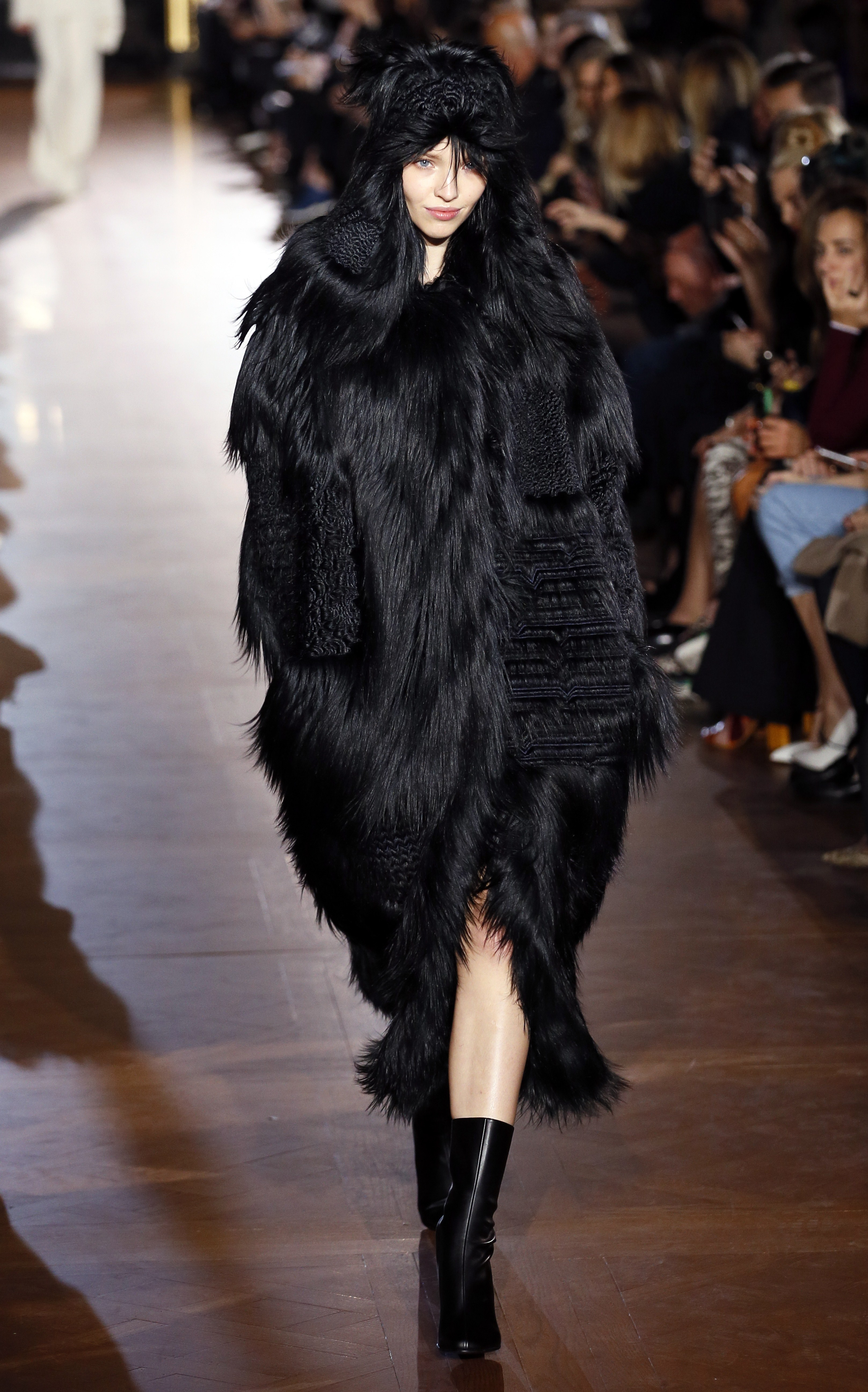 A model wears a faux fur coat during the Stella McCartney fall and winter 2015 presentation (Photo: Getty).