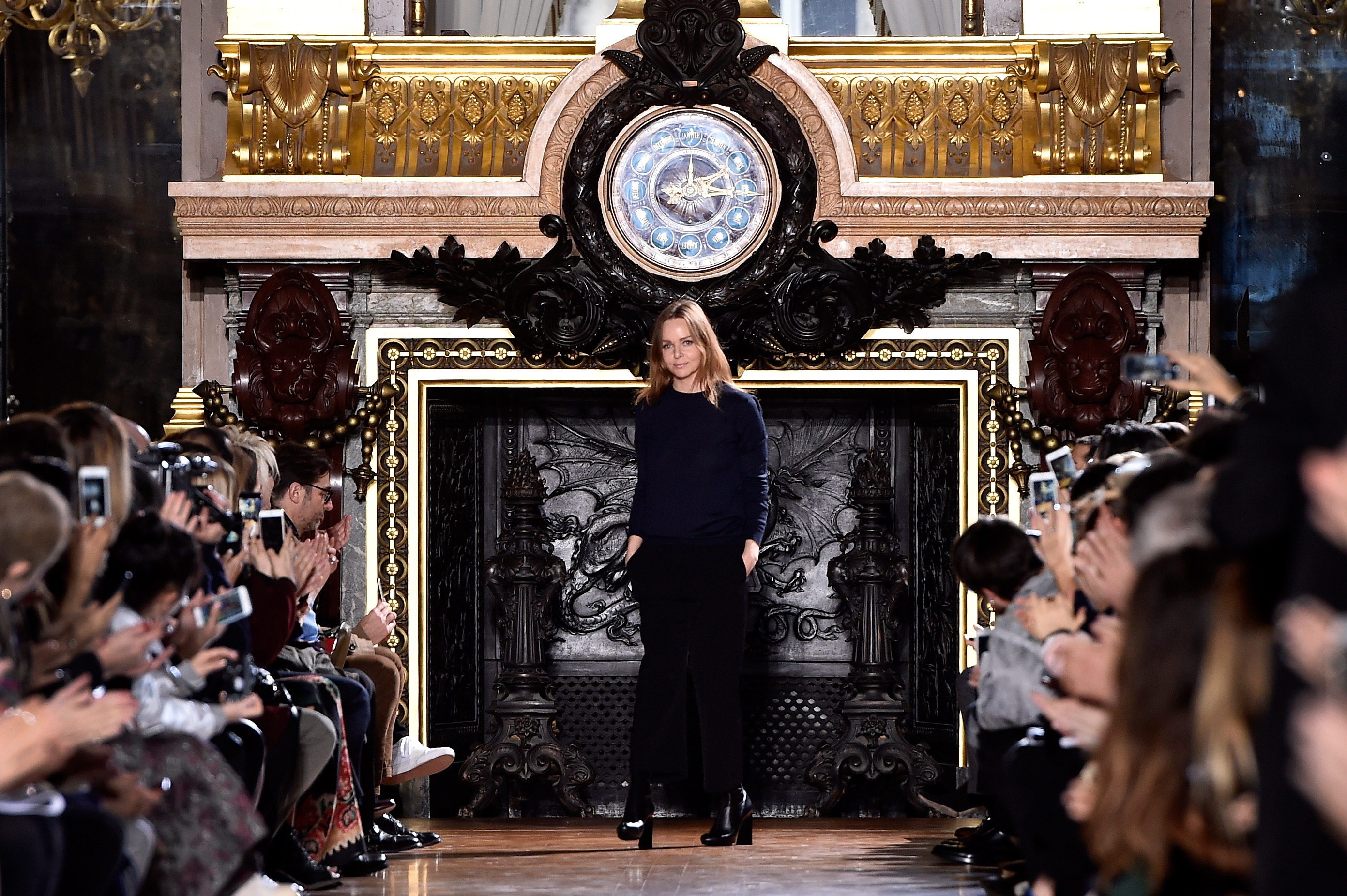 The designer herself strikes as pose (Photo: Getty).