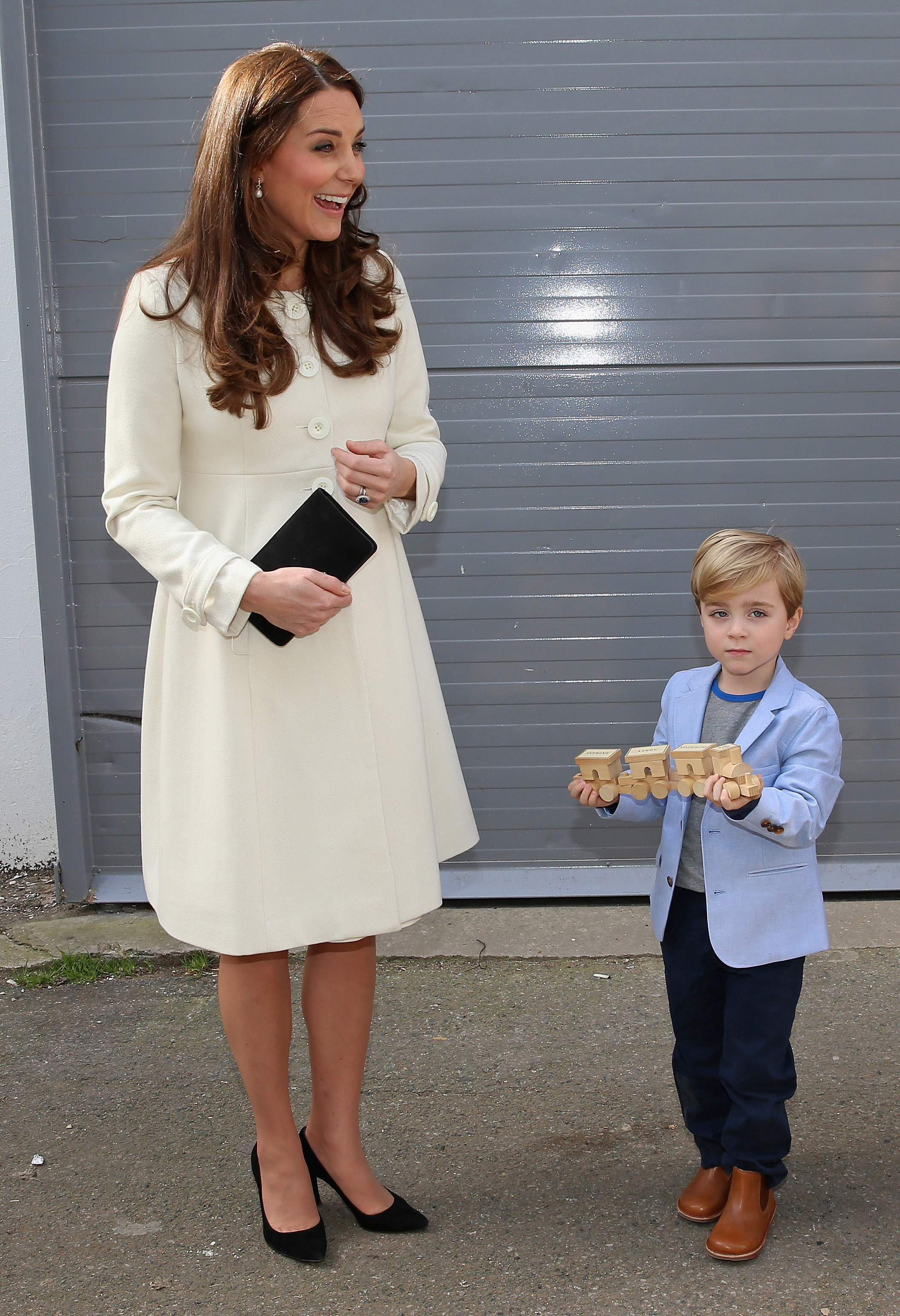 """The Duchess of Cambridge receives a gift for Prince George from """"Downton Abbey"""" actor Oliver Barker (Photo: Getty)."""