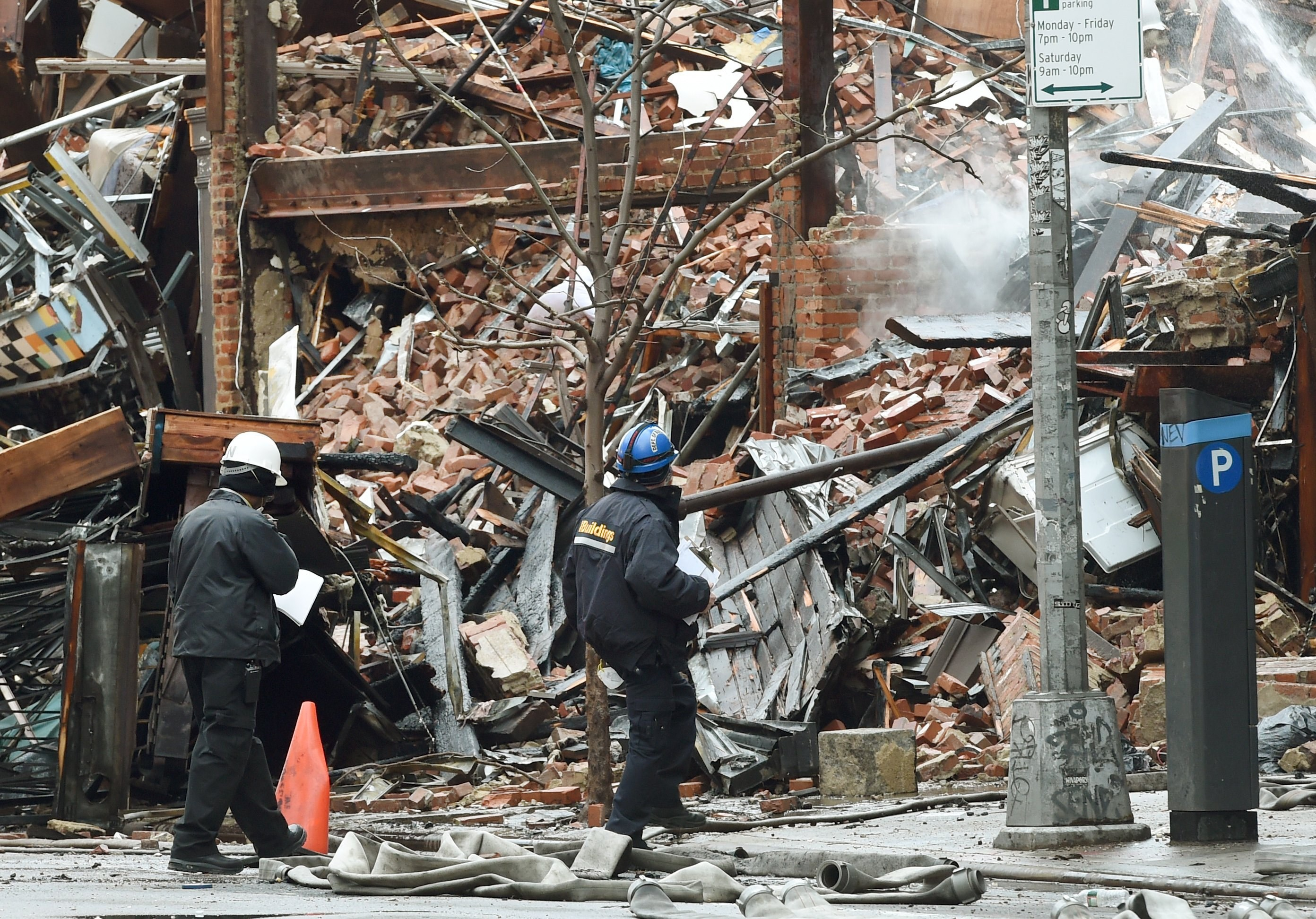 FDNY officials check debris at the site of the blast (Photo:  Timothy Clary/AFP/Getty Images).
