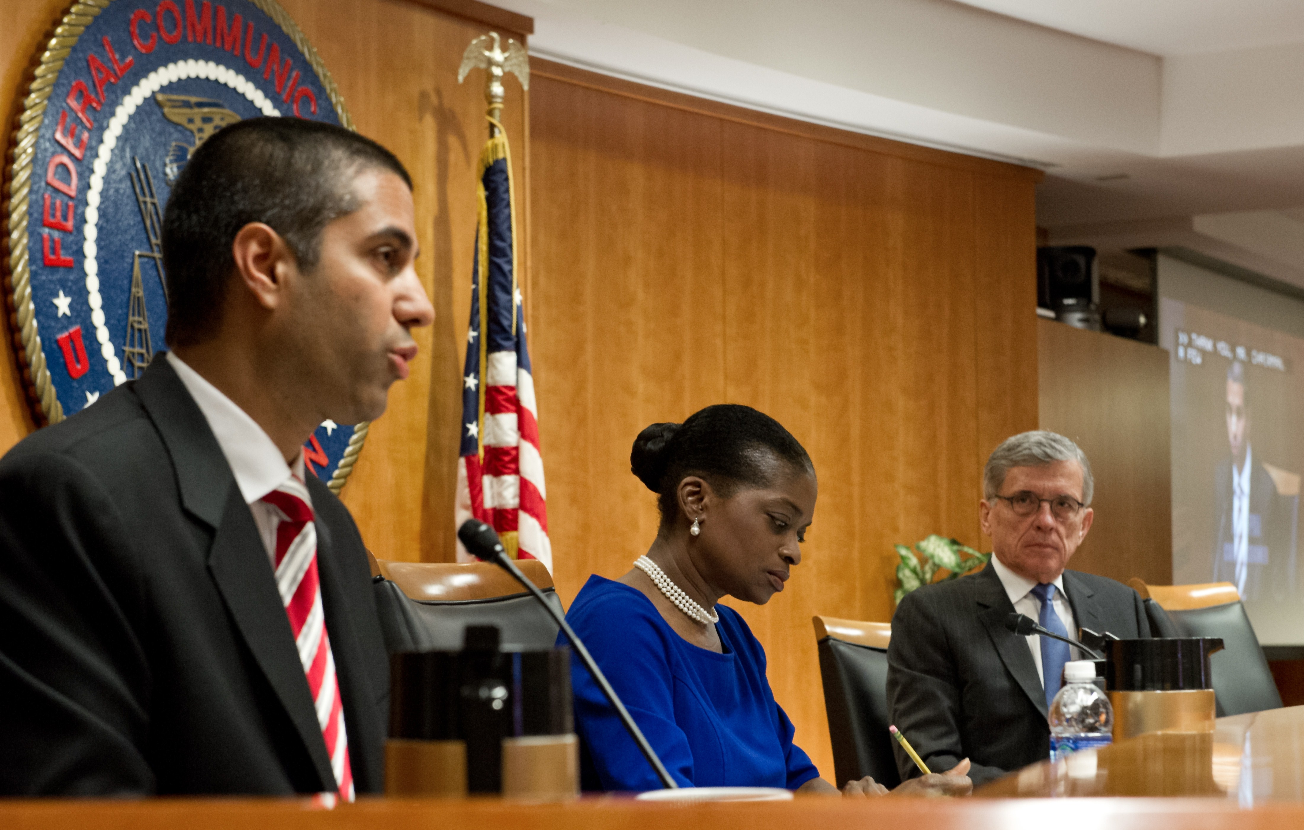 Rep. Agit Pai, pictured left, with FCC chairman Tom Wheeler giving him an appropriate stare-down. (Photo: Getty)