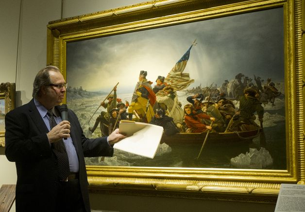"Museum partner Bob Kierlin points out some of the details in Emanuel Leutze's 1851 painting of ""Washington Crossing the Delaware"" during an unveiling at the Minnesota Marine Art Museum in Winona, Minnesota. (Photo: (Matthew Seckora, AP / Winona Daily News)"