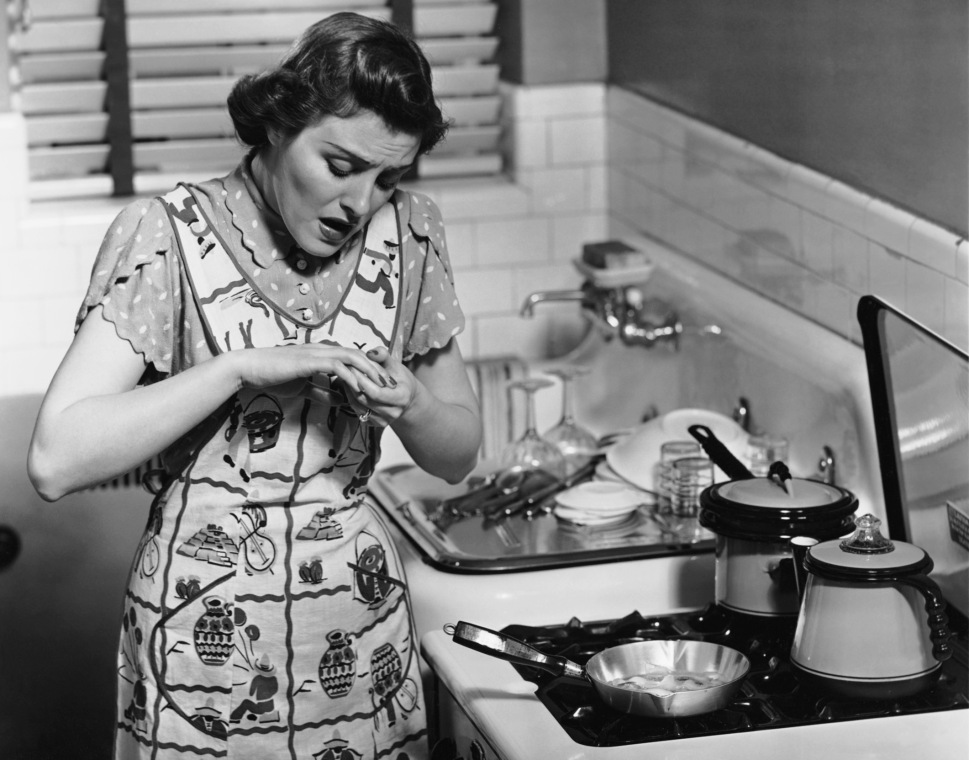 CIRCA 1950s: Woman at stove after burning hand. (Photo by George Marks/Retrofile/Getty Images)