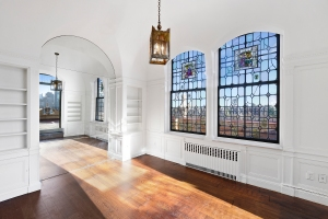Stained glass windows add a collegiate pizzazz, but the next owner may wish for a clearer view of the park. (Elizabeth Andrews for Corcoran)