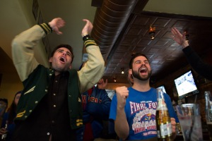 Colin Rhoads and David Wilcox celebrate a Jayhawks basket.- Mulhollands Bar, Williamsburg, Brooklyn, Aaron Adler for The New York Observer
