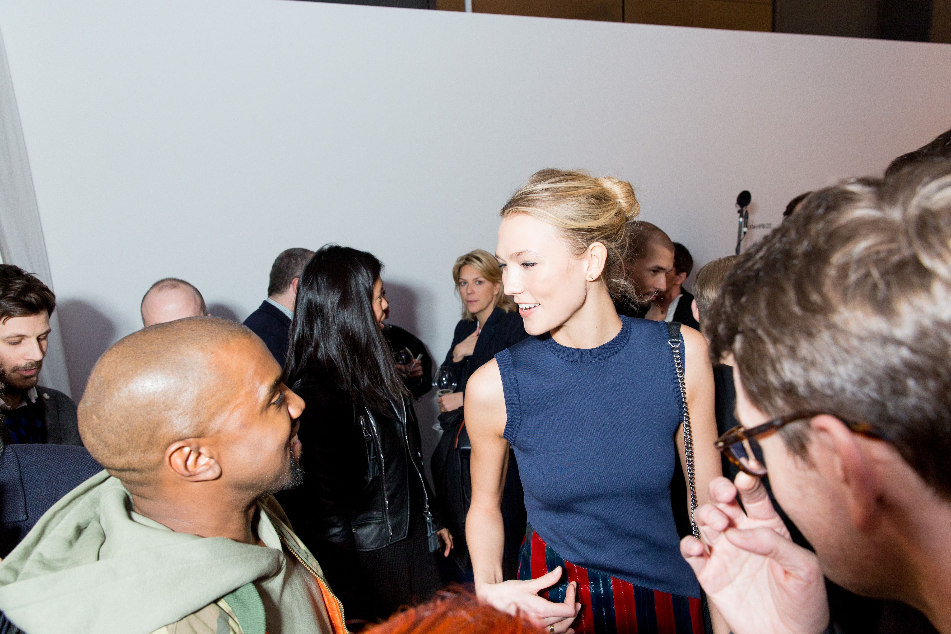 Kanye West and Karlie Kloss chat at the LVMH Prize soirée (Photo: BFA).