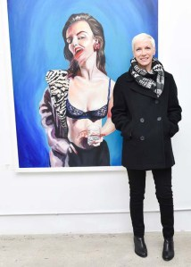 Annie Lennox, with her daughter's work. (Photo courtesy Billy Farrell