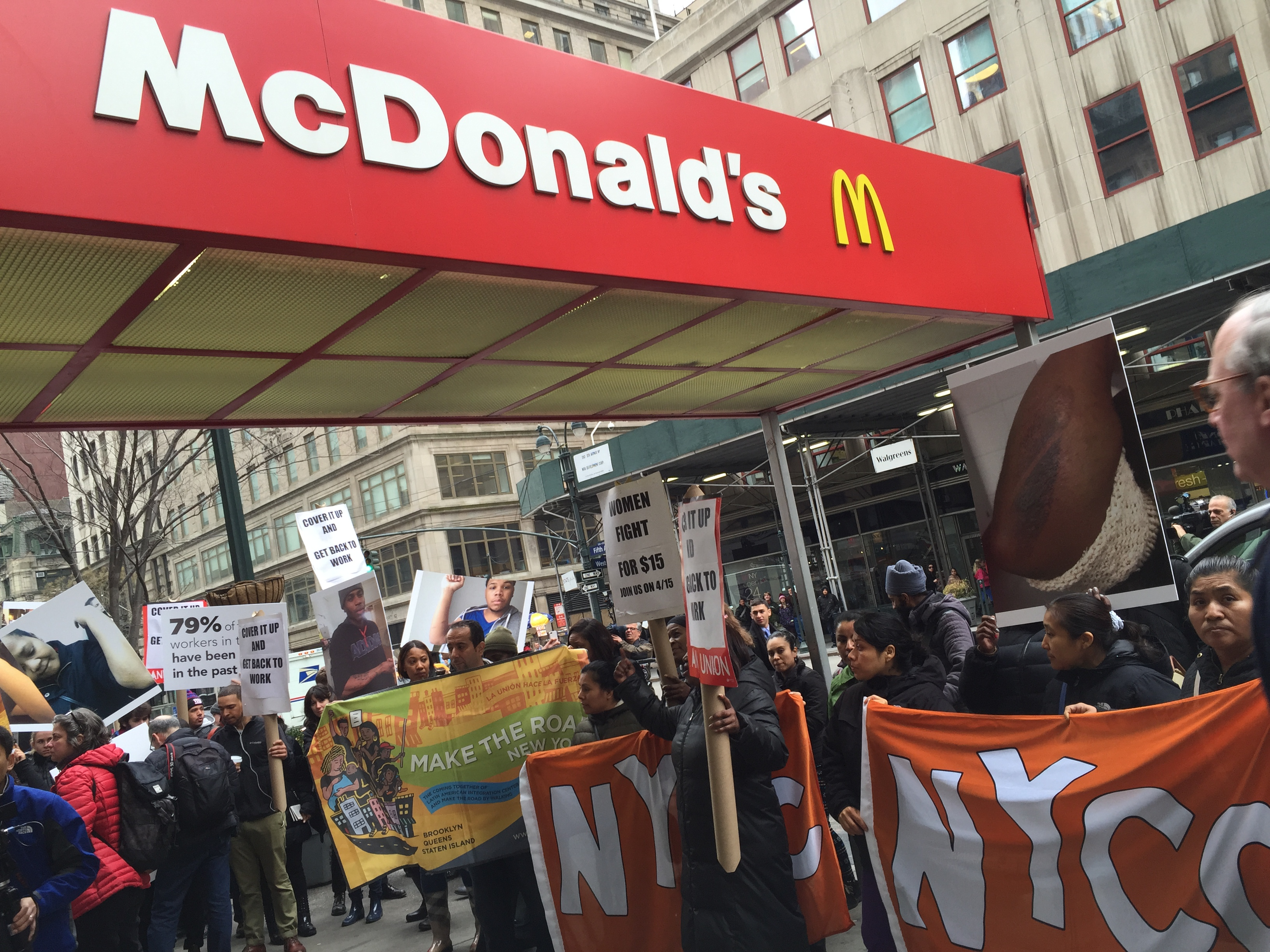 Workers rally in front of the McDonald's in Herald Square calling for better working conditions and higher wages (Ben Shapiro/New York Observer)