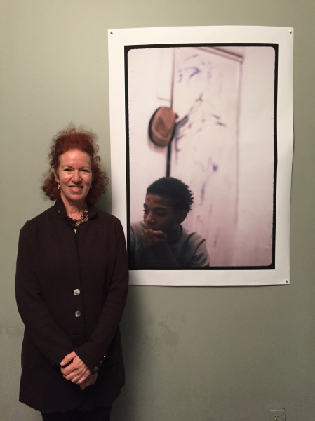 Alexis Adler with a photograph she took of Jean-Michel Basquiat while the two lived together. (Photo: Alanna Martinez)