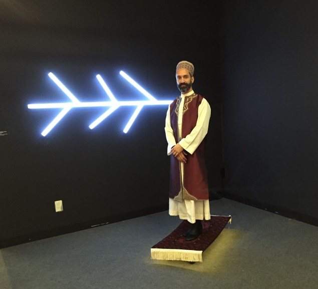 """Darvish Fakhr at the Armory Show with his work """"The Flying Carpet"""" (Photo: Alanna Martinez)."""