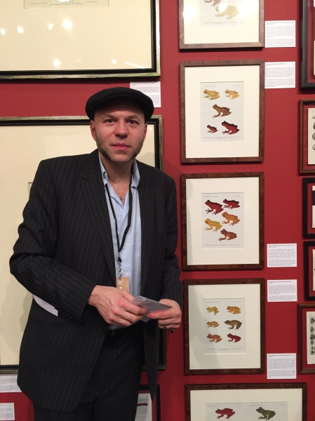 Artist Brandon Ballengée with his prints of extinct frogs. (Photo: Alanna Martinez)