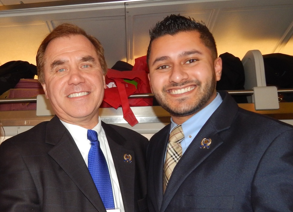 Mukherji (right) on the Chamber of Commerce train with Assemblyman Craig Coughlin (D-19).