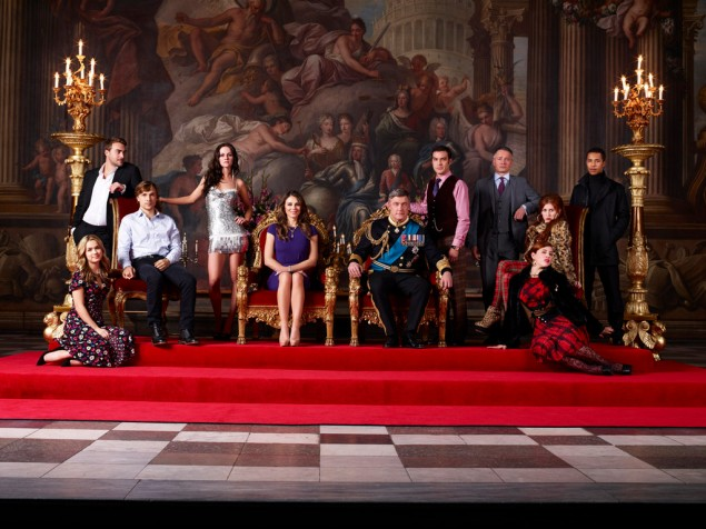 Bow to the queen: Elizabeth Hurley and cast of The Royals. (E!)