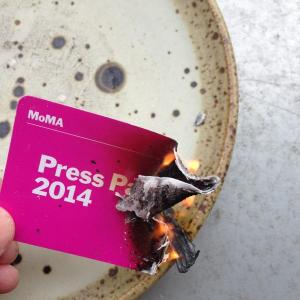 The burning press pass. (Courtesy Twitter)