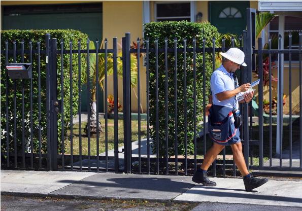 Beware your friendly neighborhood mailman. (Photo: Getty)