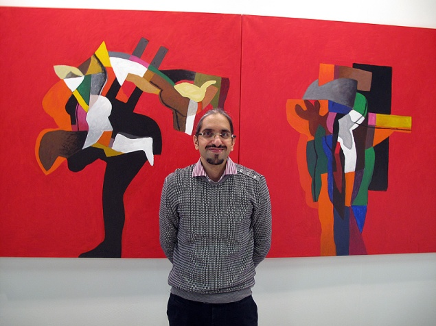 Sheikh Sultan Sooud Al Qassemi with a painting by Dia Al-Azzawi at Gallerie Claude Lemand at The Armory Show. Photo © Paul Laster