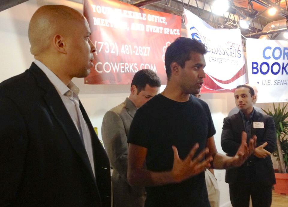 Gopal with U.S. Senator Cory Booker (left).