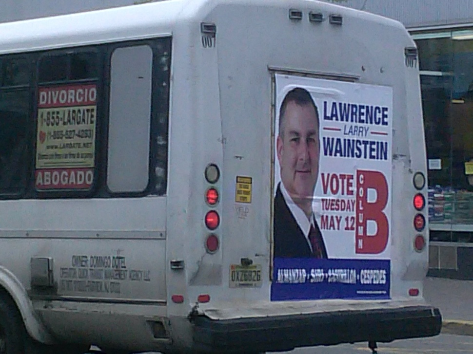 A Larry Wainstein Team sign covers the back of a bus in North Bergen in the lead-up to the May 12th election.