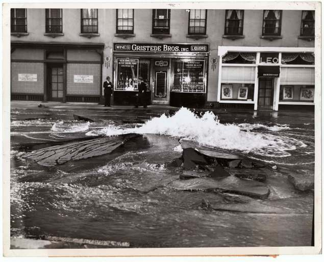 """Water Main Burst Uproots Madison Ave. New York, May 25, 1945,"" by Weegee (Photo courtesy of ICP)"