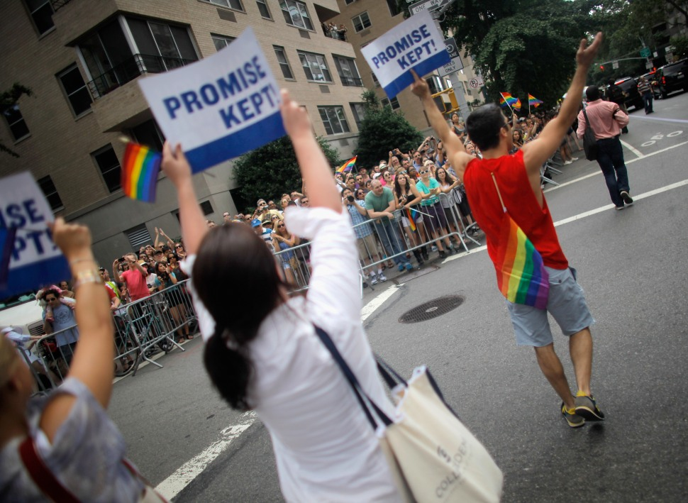 Marchers hold signs thanking Governor Andrew Cuomo for keeping his campaign promise and legalizing same-sex marriage during the 2011 NYC LGBT Pride March on the streets of Manhattan on June 26, 2011 in New York City.Thousands of revelers had reason to celebrate since New York state legislators approved a bill legalizing same-sex marriage which Governor Cuomo signed in to law on Friday June 24. (Photo by Jemal Countess/Getty Images)