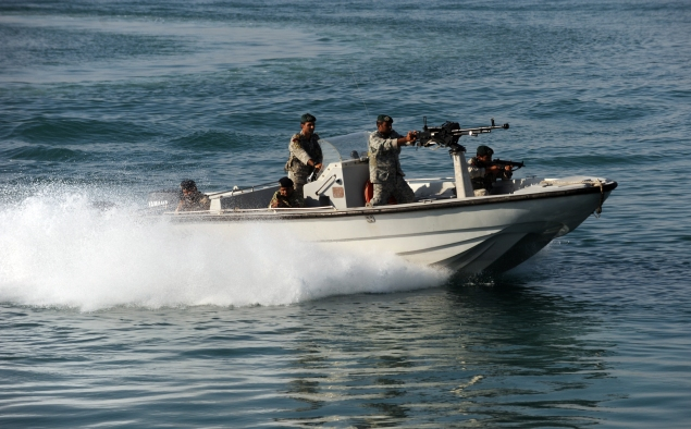 Iranian Army soldiers stand guard on a military speed boat. (ALI MOHAMMADI/AFP/Getty Images)