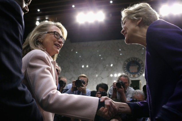 Hillary Clinton and Elizabeth Warren at a 2013 Senate hearing. (Photo by Chip Somodevilla/Getty Images)