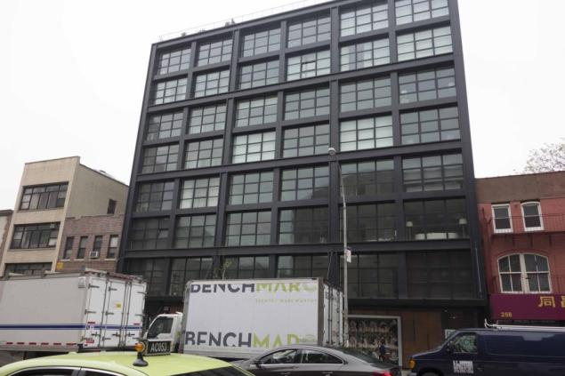 An 11,000-square-foot condo unit at 250 Bowery will become the ICP's new LES home, for a cool $23.5 million. (Photo via Commercial Observer)