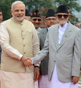 Nepalese Prime Minister Sushil Koirala (R) shakes hands with Indian Prime Minister Narendra Modi on his arrival in Kathmandu on August 3, 2014 (Getty Images)