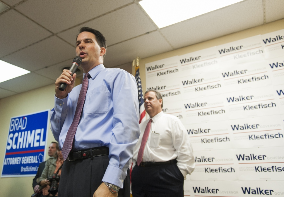Wisconsin Gov. Scott Walker joins Christie listens during a campaign stop at the GOP Field office September 29, 2014 in Hudson, Wisconsin. (Photo by Stephen Maturen/Getty Images)