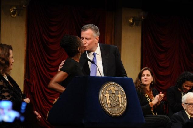 Mayor Bill de Blasio kisses his wife, Chirlane McCray. (Photo: Ilya S. Savenok/Getty Images)