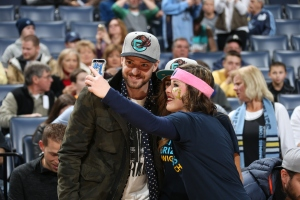 Justin Timberlake, part-owner of the Memphis Grizzlies, poses with a fan.