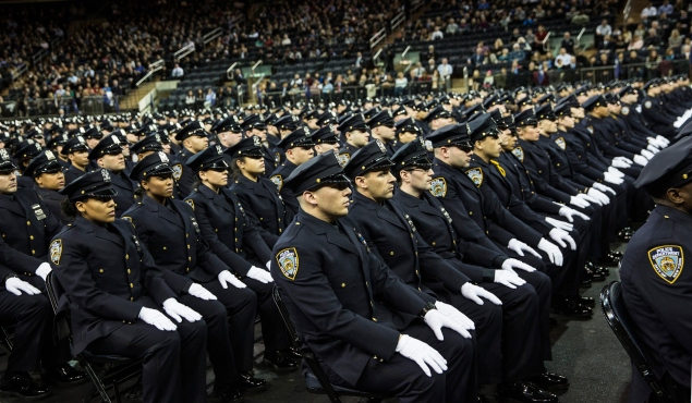 Graduates from the NYPD academy. (Photo: Andrew Burton/Getty Images)