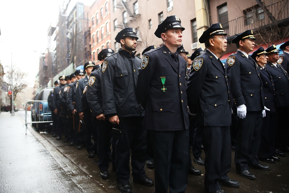 Auxiliary police officers participate in a memorial service for the 8 year anniversary of the killing of two unarmed auxiliary police officers in the West Village in New York City on March 14, 2015 in New York City. The service, which was held at the location of the 2007 crime, was attended by dozens of officers and family members of the victims 19-year-old Eugene Marshalik, a NYU student, and Nicholas Pekearo, 28. On the night of March 14, 2007 a man fired over 100 rounds of ammunition shooting and killing a pizzeria employee in Greenwich Village before fatally shooting the two auxiliary police officers. Police officers shot him on Bleecker Street. (Photo by Spencer Platt/Getty Images)
